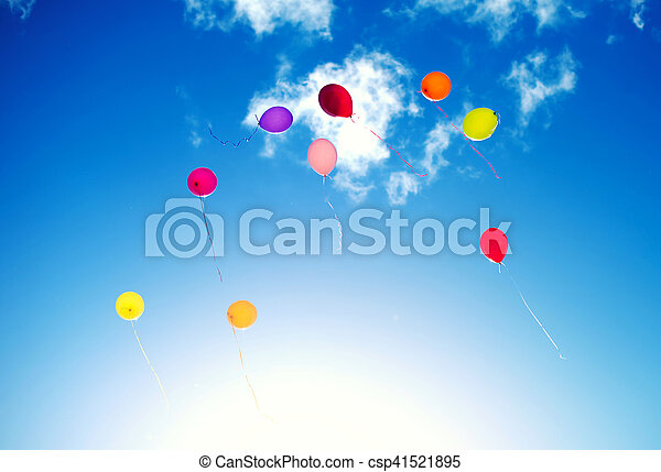 Many colorful baloons in the blue sky. - csp41521895