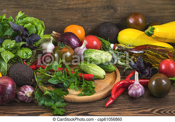 Many delicious juicy colorful summer vegetables and herbs - csp61056860