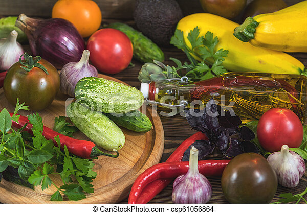 Many delicious juicy colorful summer vegetables and herbs - csp61056864