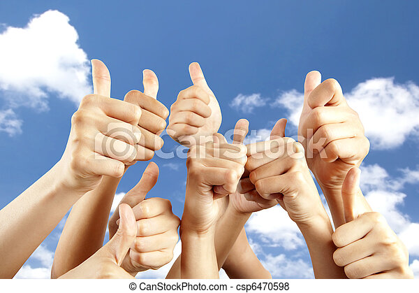 many different hands with thumb up on cloud background - csp6470598