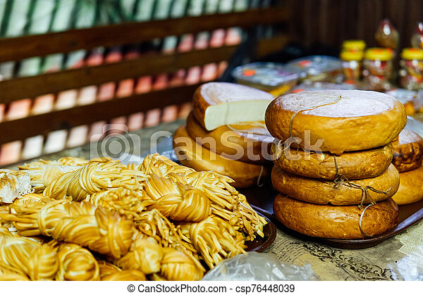 many different types of cheese on the table - csp76448039