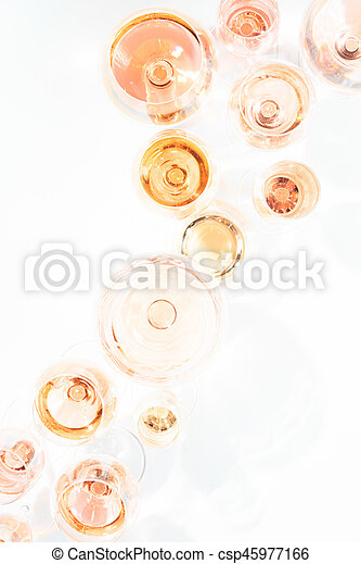 Many glasses of rose wine at wine tasting. Concept of rose wine and variety - csp45977166