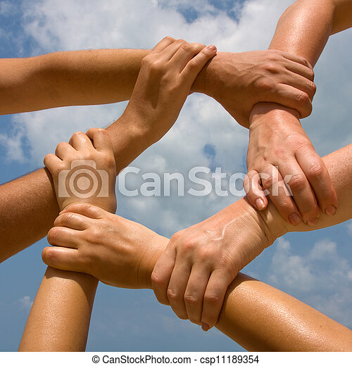 Many hands connecting to a chain with sky - csp11189354