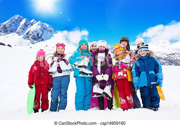 Many kids with ice skates - csp14959160