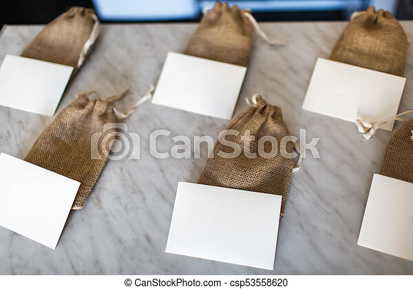 Many small brown bags of fabric and white cards - csp53558620