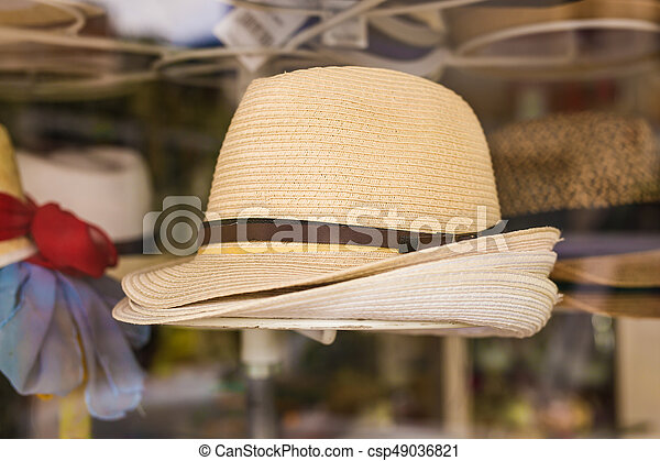 Many summer hats for sale at the market. d6cb4883e78