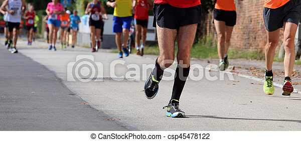 many women and men during a race in the city - csp45478122