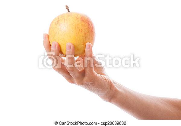Manzana en mano femenina - csp20639832