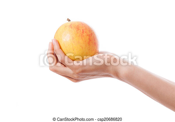 Manzana en mano femenina - csp20686820