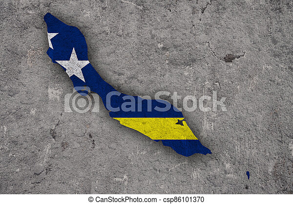 Map and flag of Curacao on weathered concrete - csp86101370