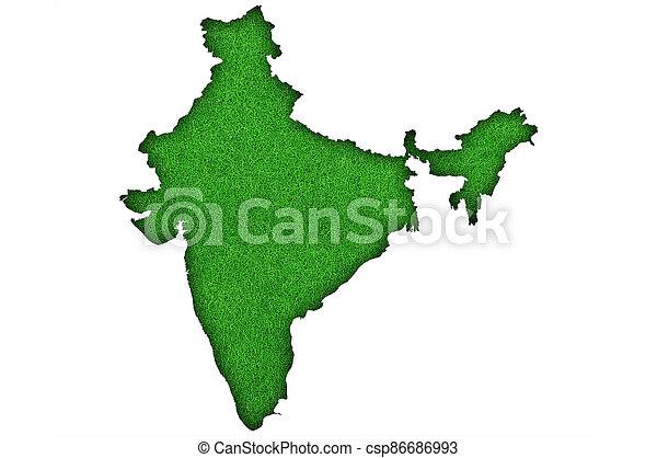 Map of India on green felt - csp86686993