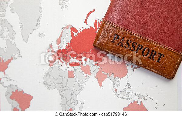 Pasaporte en un mapa de antecedentes del mundo - csp51793146
