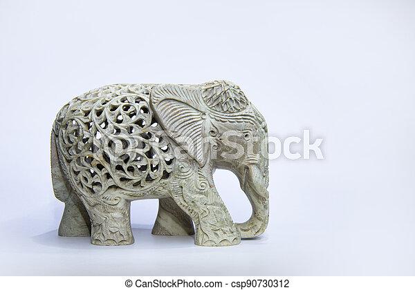 marble elephant statue on white background - csp90730312