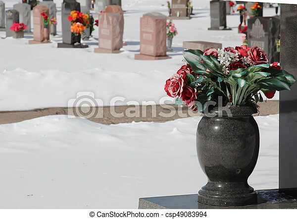 Marble Vase With Flowers In Cemetery A Cold Snowy Day At The