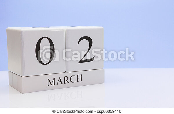 March 02st. Day 02 of month, daily calendar on white table with reflection, with light blue background. Spring time, empty space for text - csp66059410