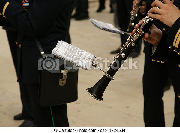 Marching military band at the parade. Clarinet - csp11724534