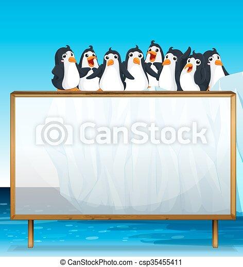 Un marco de madera con pingüinos sobre hielo - csp35455411