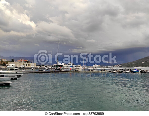 Marina with yachts the background of storm clouds - csp88793989