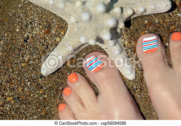 Marine Nail Designdicure With Orange And Blue Nail Polish On A