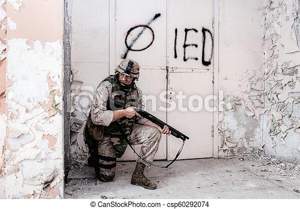 Marine shooter with shotgun take cover behind wall