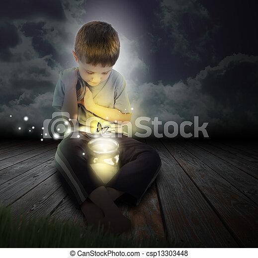 Niño insecto con mariposa brillante en la noche - csp13303448