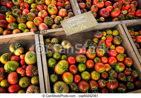 Market Tomatos Heirloom Tomatoes Produce in Wooden Boxes - csp60242361