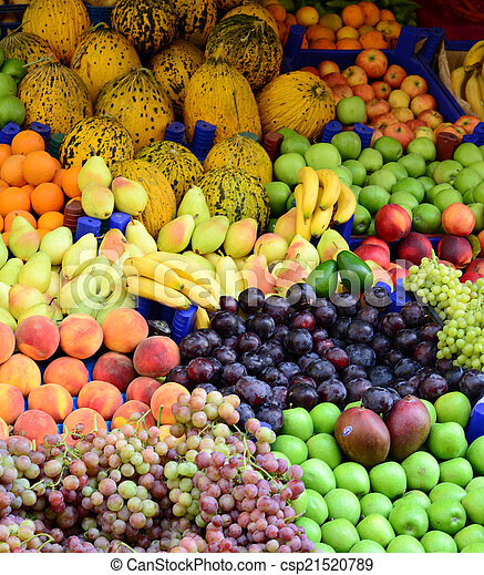 Market with various colorful fresh fruits and vegetables - csp21520789