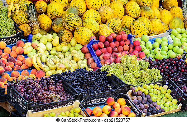 Market with various colorful fresh fruits and vegetables - csp21520757