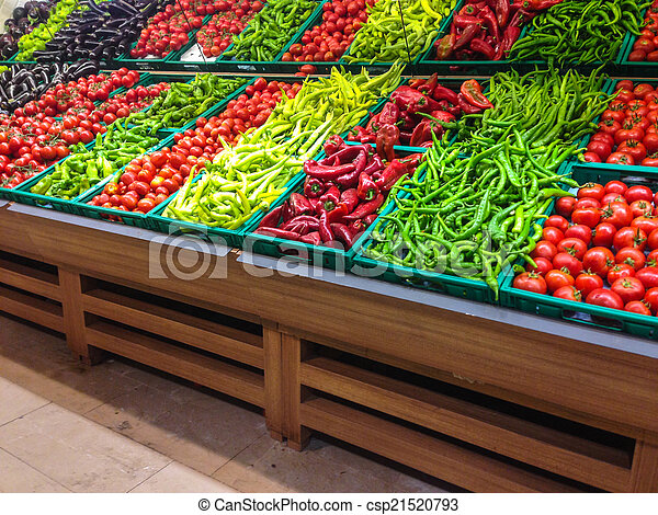 Market with various colorful fresh fruits and vegetables - csp21520793