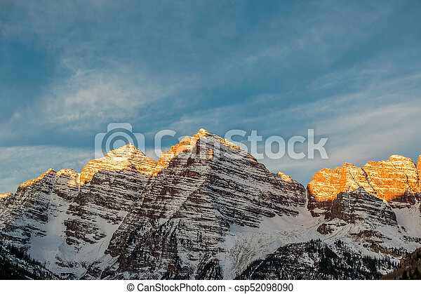 Maroon Bells mountains in snow at sunrise - csp52098090