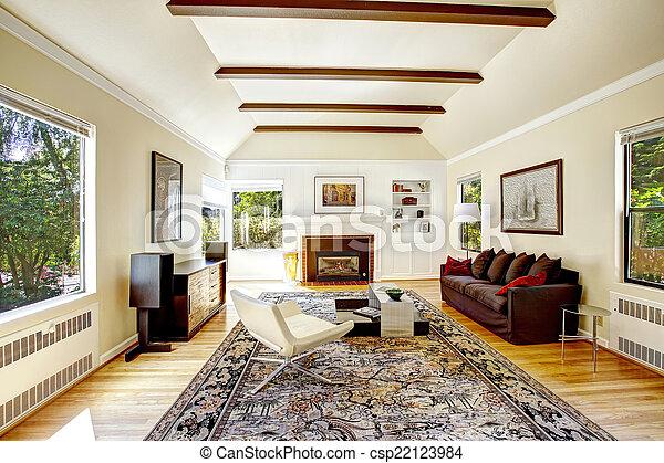 Un techo lleno de vigas marrones en la sala - csp22123984