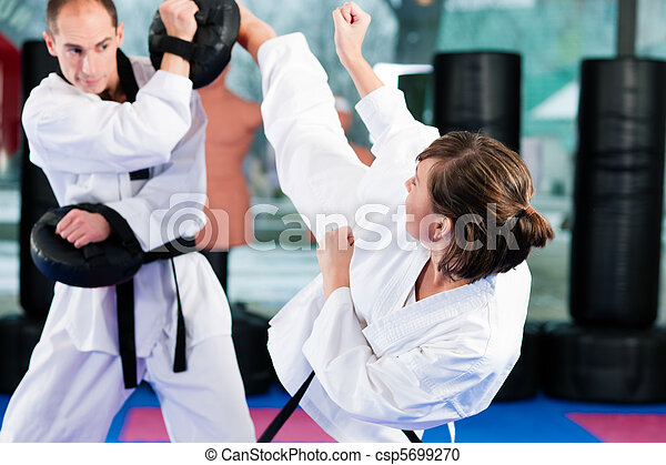 Martial Arts sport training in gym - csp5699270