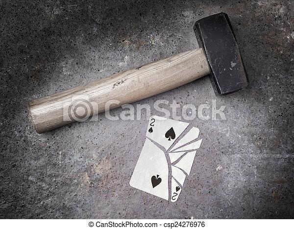 Hammer con una tarjeta rota, dos de picas - csp24276976