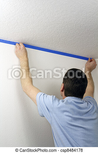 Masking a Wall with Blue Tape - csp8484178