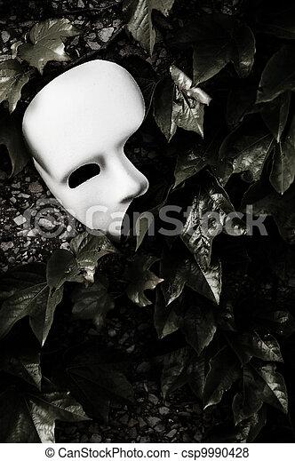 Masquerade - Phantom of the Opera Mask on Ivy Wall - csp9990428