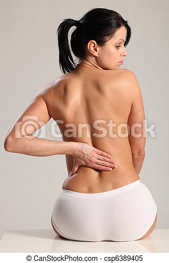 Massage lower back pain for semi nude young woman - csp6389405