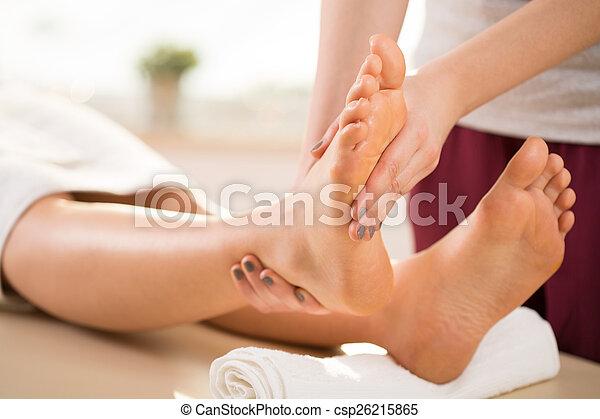 Masseur doing leg massage - csp26215865