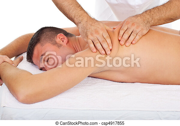 Masseur kneading man back at massage - csp4917855