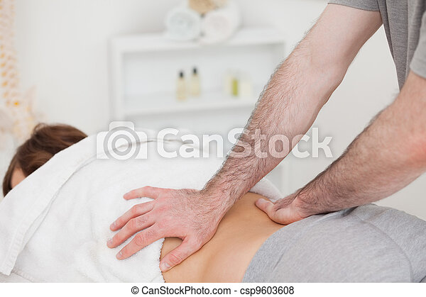Masseur massaging the back of a woman - csp9603608