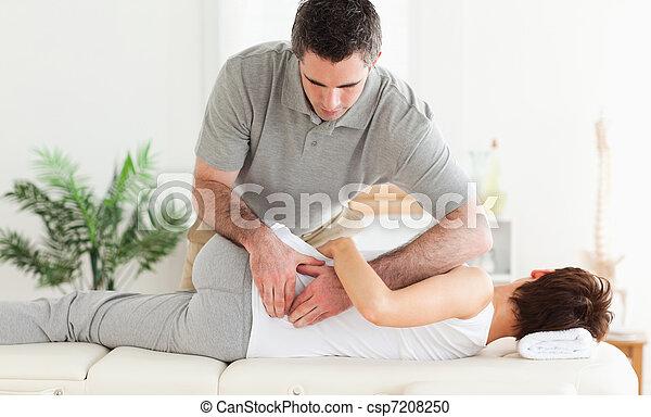 Masseur massaging woman - csp7208250