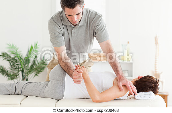 Masseur stretching woman's arm - csp7208463