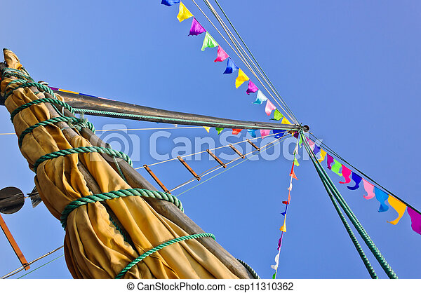 Mast and sail rolled-up - csp11310362
