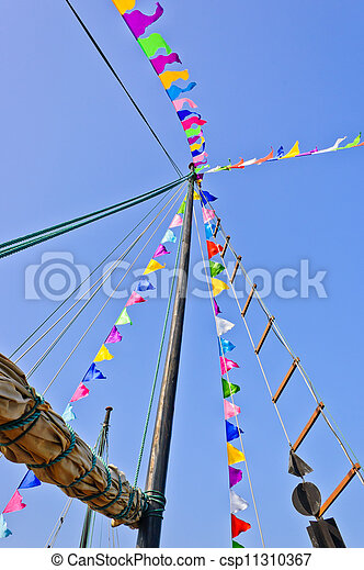 Mast and sail rolled-up - csp11310367