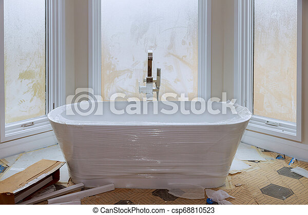 Master bath in new construction home with white tub - csp68810523