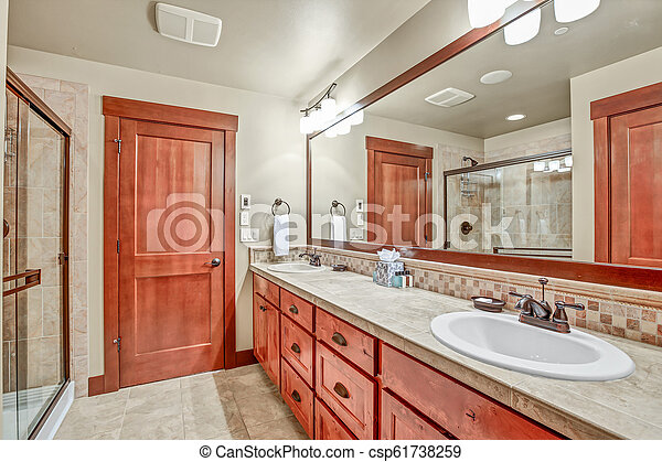 Master Bathroom With Double Sink Vanity Cabinet Master Bathroom With Double Sink Vanity Cabinet And Wood Framed Mirror
