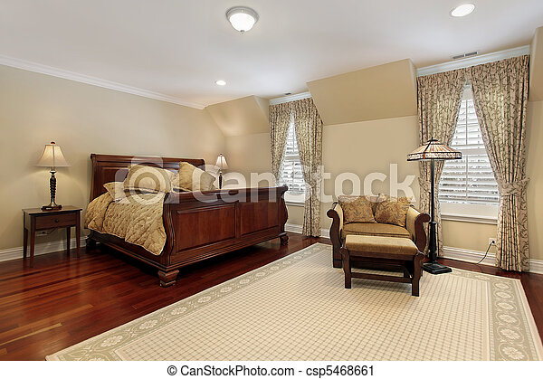 Master bedroom with cherry wood flooring - csp5468661