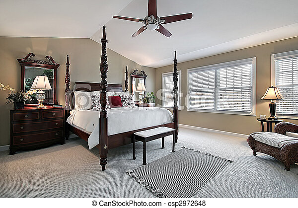 Master bedroom with dark wood furniture - csp2972648