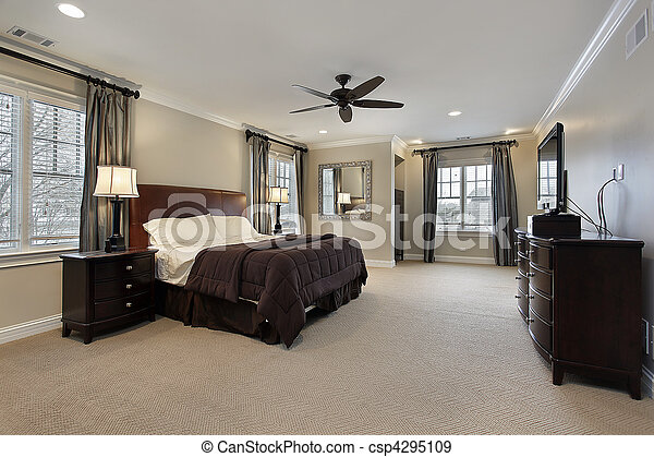Master bedroom with dark wood furniture - csp4295109