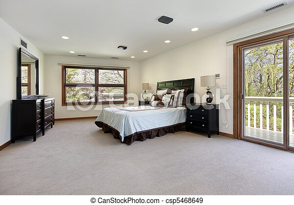 Master bedroom with door to balcony - csp5468649