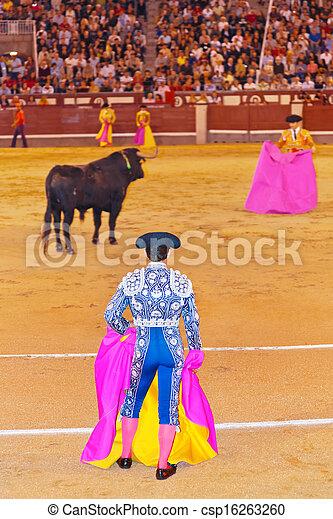 Matador and bull in bullfighting at Madrid - csp16263260